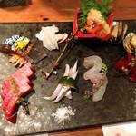 47671886 - お任せ刺し盛り2人前                       左上からしめ鯖、コウイカ、貝の酢味噌あえ、トコブシ、左下が中トロ、太刀魚、鯛、赤身