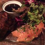 47923642 - 前菜盛り合わせ 左からキッシュっぽいもの フォアグラのテリーヌ サーモンのカルパッチョ 下には赤く色づいたポテサラ