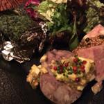 47923644 - 前菜盛り合わせ 左からサザエのグリル 猪の顔肉を冷やしてかためたもの パテドカンパーニュ