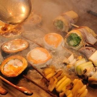 焼いた串には仕上げに出汁をかけて油分を飛ばす!