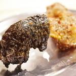 池袋 小東北串焼き - ワニ肉の小腿