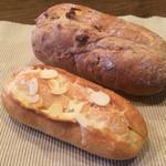 48623517 - テイクアウトのクルミパンとメイプルパン