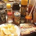 49054361 - 調味料たち。持参がオススメ☆(バター、レモン、チーズ、チリソースが美味しかった!)