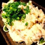 49064853 - 秋田名産いぶりがっこが入ったポテトサラダ