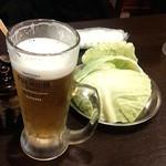 水炊き・焼鳥 とりいちず食堂 - お通し+ビール(199円+税)
