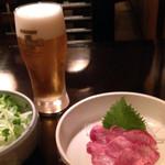 49209641 - 牛タンの刺身と野菜サラダ