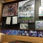 49361966 - 店内w                       『そばライス』の商標登録証とサンフレッチェ選手のサイン