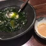 49790079 - 四十八漁場 調布店・お通しのワカメ(ゴマダレと)