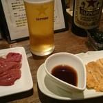 49836683 - ウニ(韓国海苔付き)と鶏肝刺し 390円