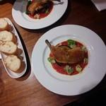 49910016 - 骨付鶏モモ肉のコンフィトマトソース/平成28年4月