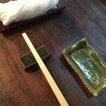 50057716 - 温かいお手拭きと箸と醤油受け