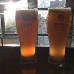ビアカフェあくら - 夕陽に映えるあくあビールです。