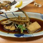 50318491 - カワハギ煮付け 奥は小魚などを揚げたもの