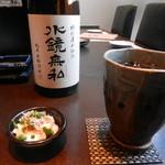 芋蔵 - お通し&米焼酎(水鏡無私)