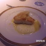 50630690 - カダイフを纏った鱸のポアレオレンジ風味のバターソース
