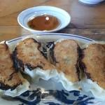 50702367 - 餃子¥350                                              この日の餃子は餡の繋ぎが多くて固く固まっていた