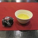 50753515 - 試食の胡麻饅頭とお茶