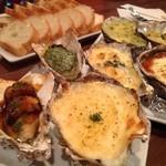 オイスターバー ゆいっとる - 牡蠣のオーブン焼き