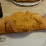クオーレ - 料理写真:ピッツァ・フリッタ、中身はヤリイカのトマトソース煮