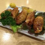 スパダイニング 憩 - ぷりぷり鶏皮ギョーザ