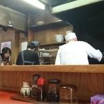 木蘭 - 厨房の店主夫妻