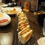 居酒屋「桜」 - リニューアル後のカツサンドです。