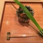 51318255 - 先付け 端午の節句に合わせてよもぎを巻いた菖蒲の葉がのっています