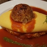51359487 - 焼きトマト&焼きチーズのトマトソースバジリコオムライス。                       上に乗ってるのは、焼きトマトです!