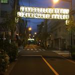 51738482 - 店の前の商店街