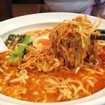 51842724 - 中洲で飲んだ後のシメに、ボリューミーで美味しい博多豚骨担々麺です♪