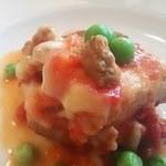 伊太めし?こるて - ホロッとトロッと「豚バラ肉のトマトソース煮」とろけるチーズで仕上げました。