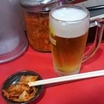 52007440 - 生ビールとキムチ