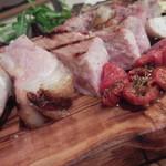 52078540 - 骨付き豚肉の炭火焼