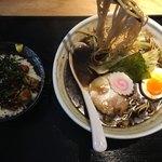 52165512 - 看板メニューの「焦がし醤油麺」と「煮込みチャーシューご飯セット」