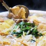 ええ処三十四番 - 美味しそうに焚き上がったスペシャルもつ鍋。野菜たっぷりで健康にも美容にも最高です。