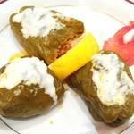 Niaribaba - ~ニューアリババ~             ひき肉とライスのピーマン詰め             ソースはヨーグルトかな?