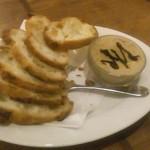 53016036 - レバーのムースをパンに塗って食べる