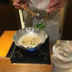 53028364 - 稲取産金目鯛のしゃぶしゃぶ  調理中