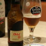 スペイン料理&ワイン パエリア専門店 ミゲルフアニ - ちょっと辛口のビール。手前がサラミと唐辛子(辛くない)のお通し