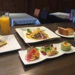 キャトルフィーユ - 7月のランチメニュー本日のお魚料理カレー風味のソース