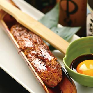 名物料理「自家製竹筒つくね焼」