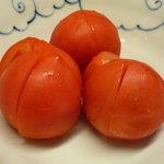 もつやき 婁熊東京 - 冷やしトマト☆北海道産のトマトを使っています。