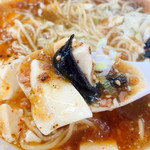 まるしん - 早速スープをお口にイン!片栗のとろみが感じられるご家庭麻婆な味わいに絹ごし豆腐の柔らかい味わい。