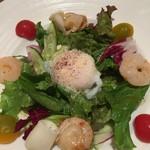 銀座びいどろ - 前菜:魚介のマリネ半熟玉子のせ。