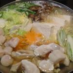 魚蔵 - 濃厚白子入り 極ふぐちり鍋の煮ているところ(ふぐコース料理・10品コース)