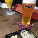旨辣中華バルFAN - ビールとオレンジジュース お通し