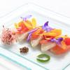 Lapin Agile - 料理写真:昆布塩と共に軽く炙ったカンパチと柑橘類のマリネ
