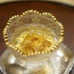54709542 - 雲丹に鯛出汁のジュレ、下には卵黄