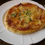 カプチーニ - ベーコンとオニオンのピザ。
