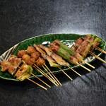 食彩家 どん吉 - 料理写真:約8割のお客さんが注文される人気メニューの串焼き盛り合わせ